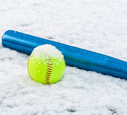 Snowball Tournament photo of bat and softball in the snow