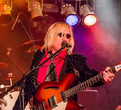 Petty Fever lead singer in action on stage performing