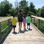 Counselor and Campers on Heritage Park Bridge